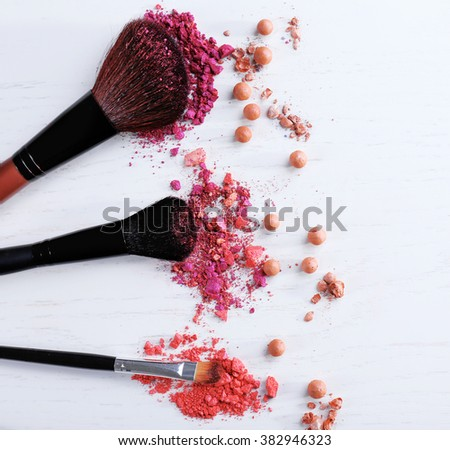 Makeup tools with powder on white background - stock photo
