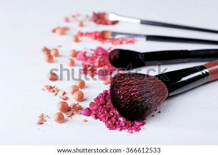 Makeup tools with powder on white background, close up - stock photo
