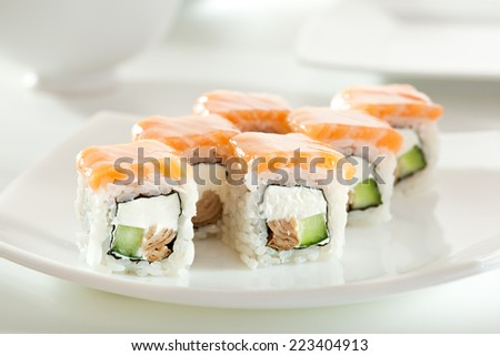 Maki Sushi made of Omelet, Cream Cheese and Cucumber inside. Salmon  outside - stock photo