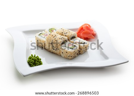 Maki Sushi - Roll made of Smoked Salmon, Cream Cheese, Cucumber and Spring Onion inside. Sesame ouside - stock photo