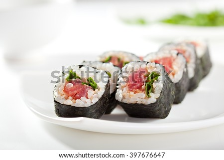 Maki Sushi with Tuna and Spring Onion inside. Nori outside - stock photo