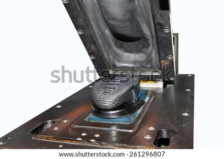 Making a designer shoes in a shoe factory. - stock photo