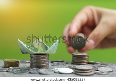 Making a origami boat Thai 20 baht banknotes / Home Savings / Mortgage Concept. - stock photo