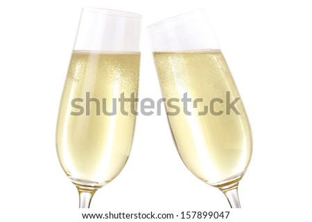 Making a toast with two glasses filled with sparkling Champagne - stock photo