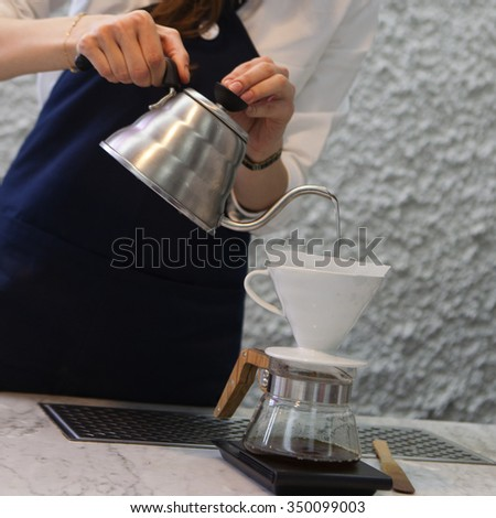 Making brewed coffee from steaming filter drip style.  - stock photo