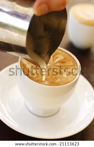 Making coffee art - stock photo
