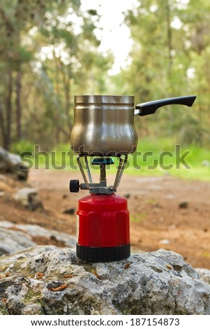 Making coffee on a gas burner on the nature. - stock photo