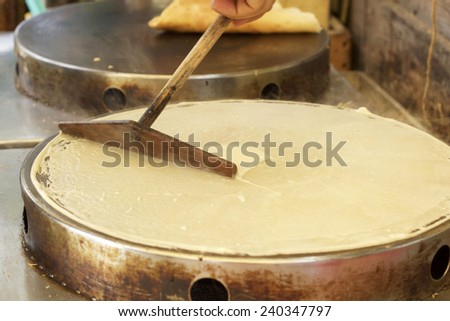 Making  crepe banana chocolate crispy pancake - stock photo