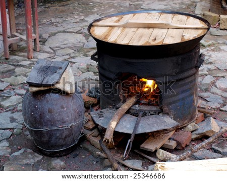 Making dinner by cooking stove which is a traditional cooking style in Chinese village. - stock photo