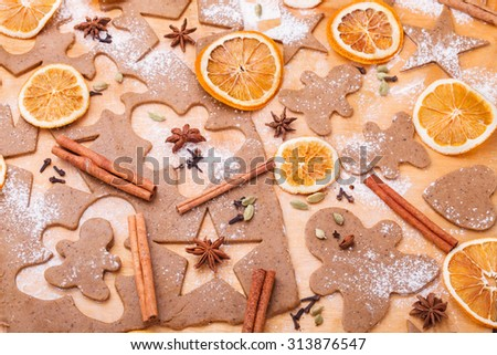 Making gingerbread cookies. Christmas baking background dough . - stock photo