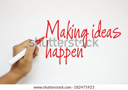 Making Ideas Happen sign on whiteboard - stock photo