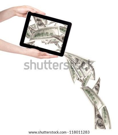 making money with computer concept - Money pouring out from a Tablet pc - stock photo