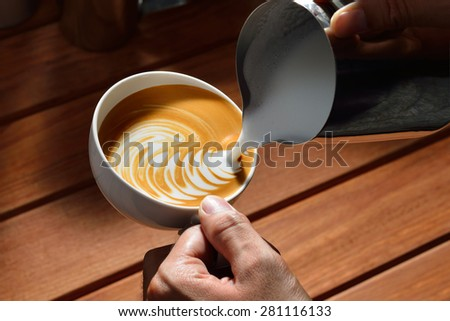 Making of cafe latte art, bird shape - stock photo