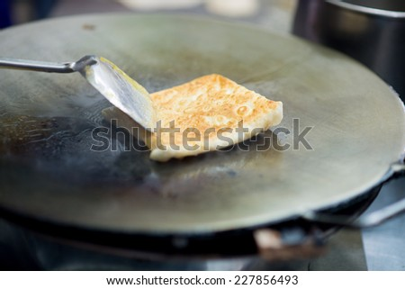 Making of roti, South Asian bread - stock photo