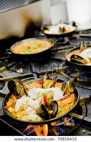Making paella - stock photo
