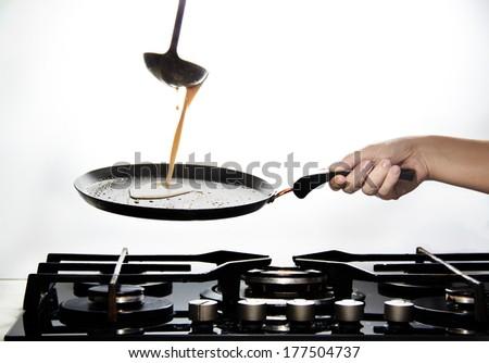 Making Pancakes on frying pan  - stock photo
