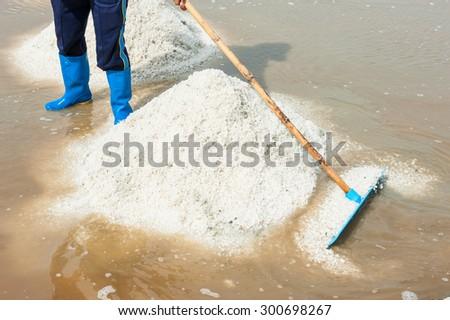 Making pyramid of salt,Thailand. - stock photo