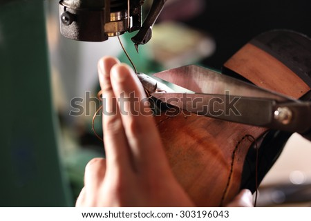 Making shoes. Sewing machine. shoemaker sews shoes.  - stock photo