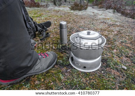 Making soup in the woods with camping stove/Cooking in the woods - stock photo