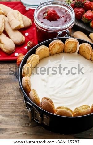 Making strawberry cheese cake - stock photo