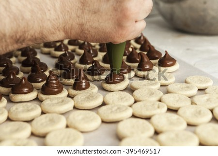 Making sweets with a lot of chocolate - stock photo
