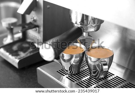 Making two espressos on stainless steel home espresso machine. - stock photo