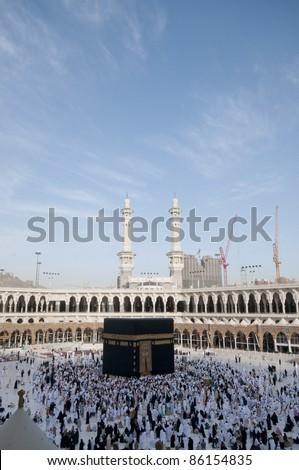 MAKKAH - APRIL 24 : Pilgrims circumambulate the Kaaba at Masjidil Haram on April 24, 2010 in Makkah, Saudi Arabia. Muslims all around the world face the Kaaba during prayer time. - stock photo