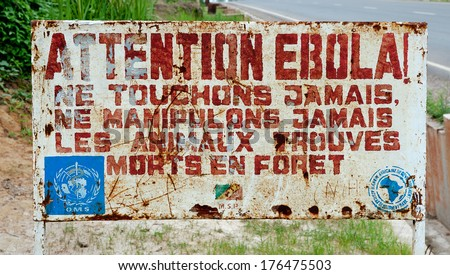 MAKOUA, CONGO, AFRICA - SEPTEMBER 27: A sign warns visitors that area is a Ebola infected. Signage informing visitors that it is a ebola infected area. September 27, 2013,Congo, Africa. - stock photo