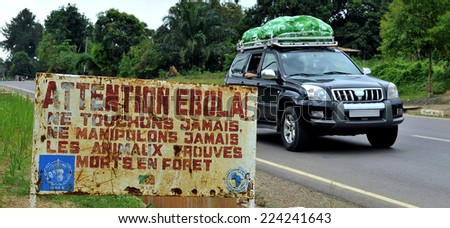 MAKOUA, CONGO, AFRICA - SEPTEMBER 27: Car and sign warns visitors that area is a Ebola infected. Signage informing visitors that it is a ebola infected area. September 27, 2013,Congo, Africa.   - stock photo
