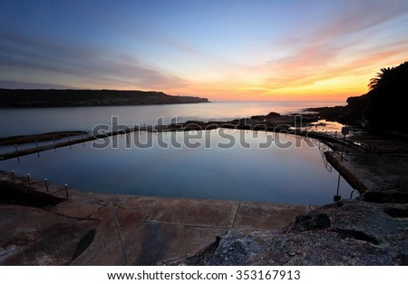 Malabar pool viewed from cliff above with a dawn sky just starting to colour up - stock photo
