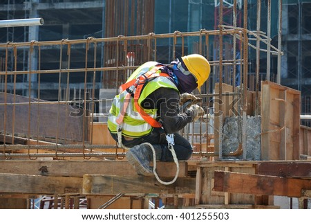 MALACCA, MALAYSIA -OCTOBER 13, 2015: Construction workers fabricating steel reinforcement bar at the construction site in Malacca, Malaysia - stock photo