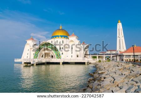 Malacca Straits Mosque (Masjid Selat Melaka) with blue sky, Malacca, Malaysia - stock photo