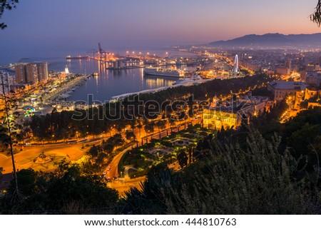 Malaga cityscape after sunset. Spain - stock photo