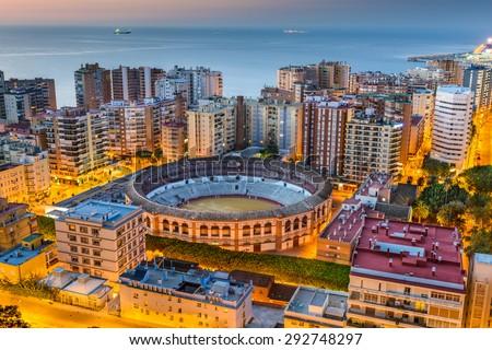 Malaga, Spain cityscape and bullring at dawn. - stock photo
