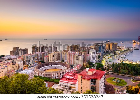 Malaga, Spain dawn skyline towards the Mediterranean Sea. - stock photo