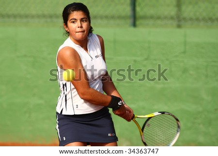 MALAGA, SPAIN – JANUARY 11 : Maria Jose Luque in action during the final match of the 1st round of the Nike Junior Tennis Tour tournament at Malaga Tennis Club January 11, 2009 in Malaga, Spain. - stock photo