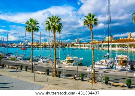 MALAGA, SPAIN, JANUARY 4, 2016: people are walking on a promenade surrounded by marina in the port of malaga in spain. - stock photo