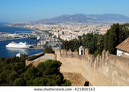 MALAGA, SPAIN - JULY 11, 2008 - Gibralfaro castle battlements with views over the city and port, Malaga, Malaga Province, Andalucia, Spain, Western Europe, July 11, 2008. - stock photo