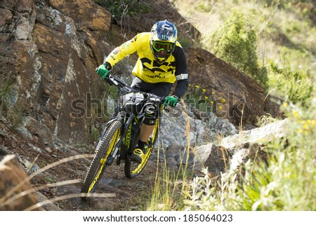 "MALAGA, SPAIN - MARCH 30: Unknown racer on the competition of the mountain bike ""BIG RIDE Open to Spain to Enduro"" on March 30, 2014 in Malaga, Spain - stock photo"