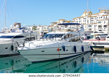 MALAGA, SPAIN - MAY 9: Malaga's marina pictured on May 9th, 2015 in Malaga, Spain. Malaga is the second largest city of Andalusia and the sixth largest in Spain.     - stock photo