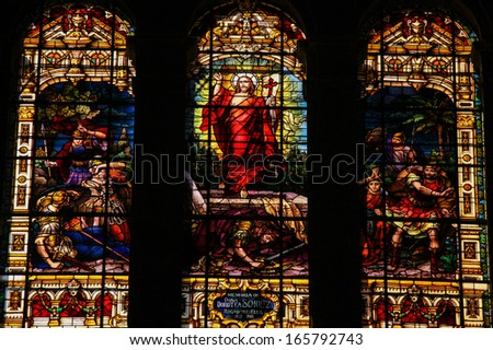 MALAGA, SPAIN - NOV 29: Stained glass window depicting Jesus rising from the grave, located in the cathedral of Malaga, Spain, on November 29, 2013. - stock photo