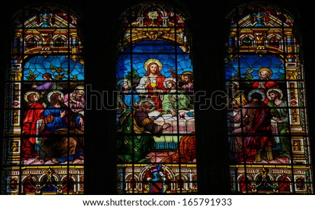 MALAGA, SPAIN - NOV 29: Stained glass window depicting the Last Supper, in the cathedral of Malaga, Spain, on November 29, 2013.  - stock photo