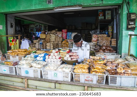 MALANG, WEST JAVA, INDONESIA - SEPTEMBER 18: Local men selling foods in Malang, Java, Indonesia on September 18, 2012. - stock photo