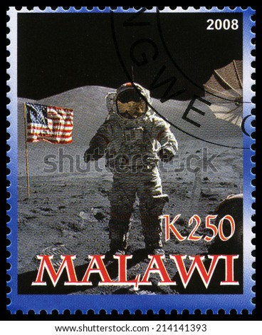 MALAWI - CIRCA 2008: A used postage stamp from Malawi commemorating the Apollo 17 Moon Landing, circa 2008. - stock photo