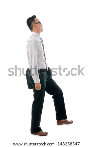 malay business man walking with smiling expression, full length portrait isolated over white background. - stock photo