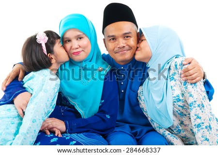 Malay girls kiss their parent - stock photo