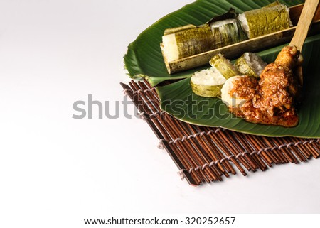 malay lemang served with rendang ayam - stock photo