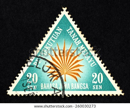 MALAYA - CIRCA 1962: Blue color triangle shaped postage stamp printed in Federation of Malaya with illustrative image of a fan palm leaf.   - stock photo