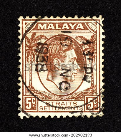MALAYA - CIRCA 1938: Brown color postage stamp printed in Malaya for the Malayan Straits Settlements with portrait image of King George VI. - stock photo