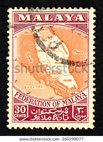 MALAYA - CIRCA 1956: Postage stamp printed in Federation of Malaya with illustrative image of Malaya geographical map. - stock photo